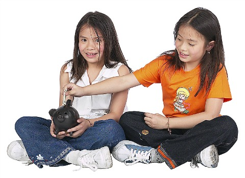 two girls with piggy bank