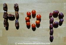 word 'hop' spelt in fruit