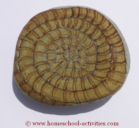 pebble painted as an ammonite