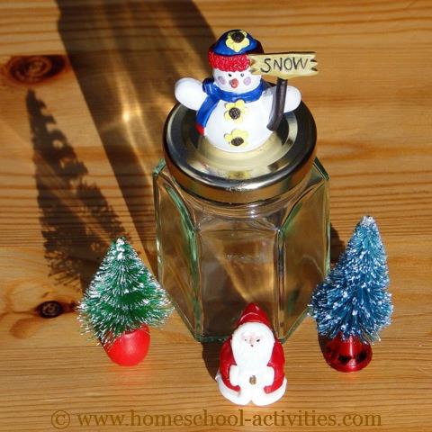 glass jar and snow globe figures