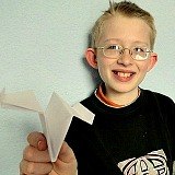 William with his paper airplane