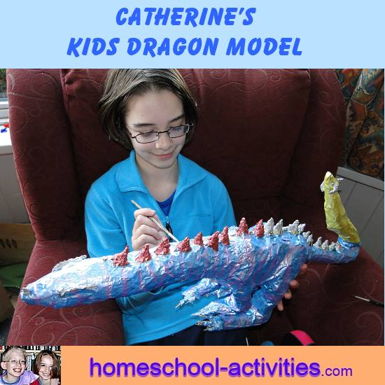 Catherine painting paper mache dragon