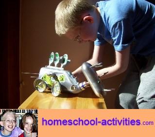 child building a dinosaur robot