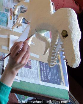 painting Velociraptor model