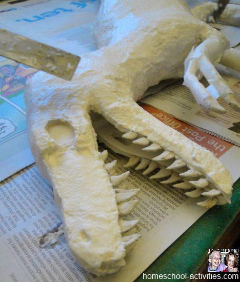 adding paper mache clay to Velociraptor