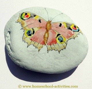 pebble painting with a butterfly