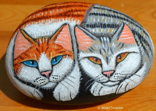 hand painted rock of two cats